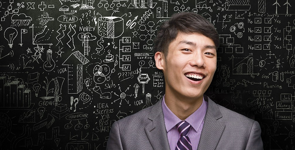 CEO In Front Of Black Board Of Ideas